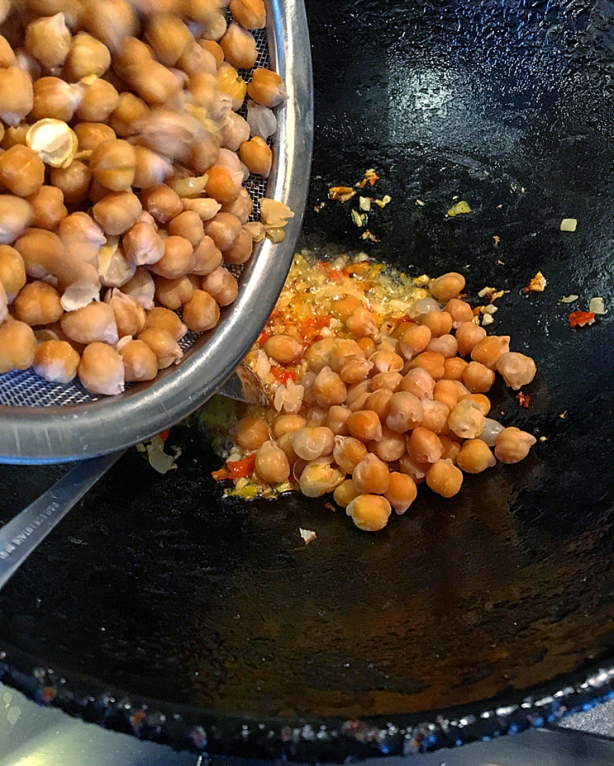 When the garlic and onion mixture are light brown add the chickpeas.